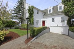 House colonial white with red door exterior front. Stock Photo