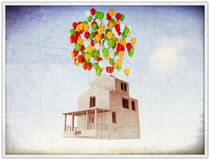 House with colored ballons on the roof. White house with colored balloons on the roof Stock Photo