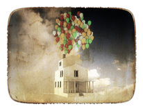 House with colored ballons on the roof. White house with colored balloons on the roof Stock Images