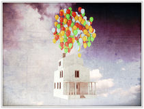 House with colored ballons on the roof. White house with colored balloons on the roof Stock Photos