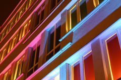 House in colored light. House and windows in light with different colours in the night Stock Photography