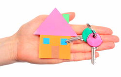 House of colored paper and home keys in hand Royalty Free Stock Photo