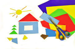 House and colored paper. Colored paper, scissors and application of colored paper on a white background Stock Photography