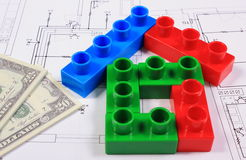 House of colorful building blocks and banknotes on drawing of home Stock Photo