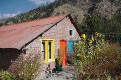 House with colorful doors and windows Stock Photos