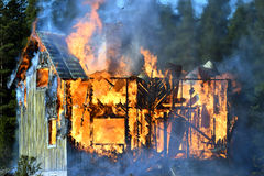 House completely engulfed in flames.  Royalty Free Stock Image