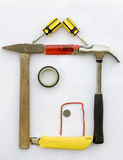 House concept. A house shape is made of  constructing tools,such as hammer,knife,screwdriver,lighter,coin,cement.This house has a smaller top Stock Image