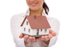 House concept. Businesswoman holding a mini house for real estate concept Stock Image