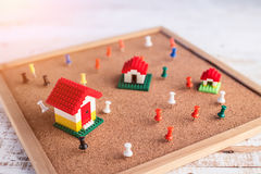 House concept mini toy house on corkboard Stock Photos