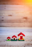 House concept mini toy house on white wooden Royalty Free Stock Photo