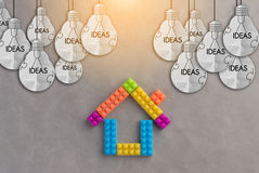 House concept with plastic blocks toy with paper cut ideas shape. On leather floor Royalty Free Stock Image