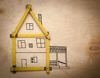 House concept with yellow meter on wooden Stock Images