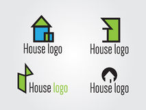 House logo pack. 4 conceptual house logos in green and blue Royalty Free Stock Photo