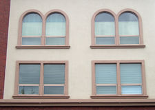 House concrete building stucco wall arch windows Stock Images