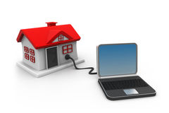 House connected to laptop computer Stock Photos