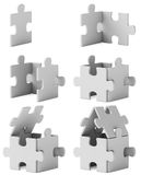 House consequent assembly. Puzzle home on whihe background Stock Images