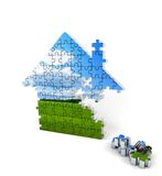 House consisting of puzzles on white Royalty Free Stock Photography