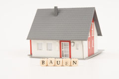 House construct german. House with the word construct in german Royalty Free Stock Photos