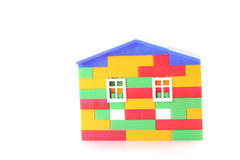 House constructed from toy bricks isolated Royalty Free Stock Photography