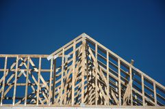 House Construction. Construction of a house using lumber and trusses royalty free stock image