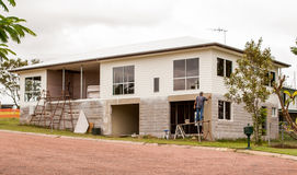 House construction. Builder applying concrete render to exterior of new house Royalty Free Stock Photo