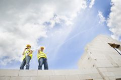 House construction. Construction Contractors building a big new home Stock Image