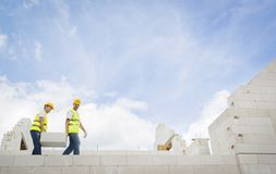 House construction. Construction Contractors building a big new home stock images