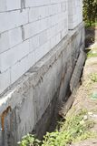 House construction without foundation bitumen waterproofing. Building construction errors. Foundation construction mistakes stock images
