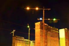 House construction. Night snapshot. Tower crane. stock photography