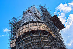 House construction, renovation. Construction, building, reparation, restoration, renovation, insulation of a large building framed by scaffolding Stock Images