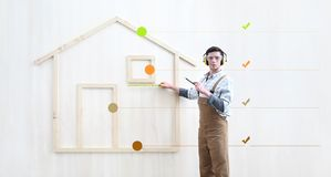 Free House Construction Renovation Concept Handyman Carpenter Worker Man With Meter  Measure And Show The Model Of A Wooden House Royalty Free Stock Photography - 149735707