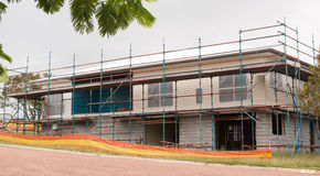 House construction with scaffold. Building using scaffold during construction for safety Stock Image