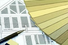 House Construction Siding. House plans with a fan of vinyl siding samples