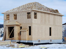 House Construction In Winter. Residential building construction in winter royalty free stock photo