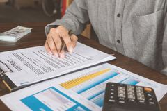 House Contract, Man signs a contract to purchase a home with a r stock images