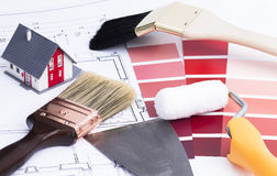 House contruction. Image shows some brushes a painter roller and color palette Stock Photo
