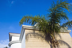 House corner. Against the blue sky background and palm tree in front Royalty Free Stock Photos
