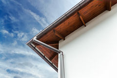House corner with gutter Stock Photo