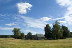House in the country. Landscape with  house in the fields Stock Photo