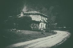 House in the countryside near road with vintage filter. House in the countryside near a road with vintage filter stock images