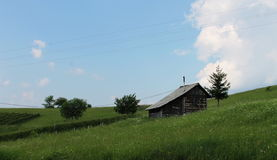 House on the countryside. Old wooden house in the nature. Untouched meadows and trees with fresh air Stock Images