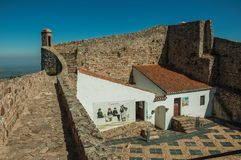 House and courtyard encircled by wall at the Marvao Castle. Marvao, Portugal - July 09, 2018. House and courtyard encircled by thick stone wall, on sunny day at stock images