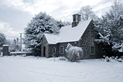 House covered in snow ireland. A stone gate lodge house covered by snow in ireland Royalty Free Stock Images