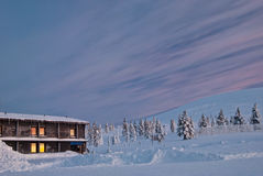 House covered with snow and sunrise Stock Photo