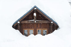 A house covered with thick snow on snowy day.  Stock Images