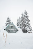 A house covered with thick snow on snowy day. Stock Photography