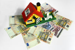House credit. Lego house on 50 euro background Royalty Free Stock Photo