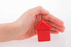 House with cubes in hand Stock Photos