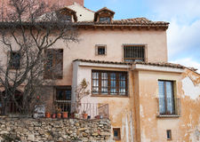 House in Cuenca with pomegranate tree on foreground Royalty Free Stock Photography
