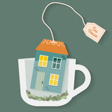 House in cup of tea. Royalty Free Stock Photography